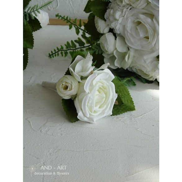 Groom boutonniere made of white silk flowers